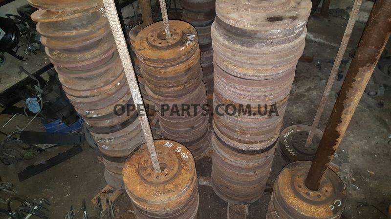 Тормозной барабан задний 568063 б/у на Опель Astra H